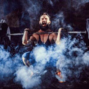 Split-routines-Bodybuilder Doing An Overhead Press